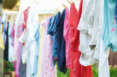 image of clothes on a line explaining that drying clothes indoors leads to bad odours and condensation
