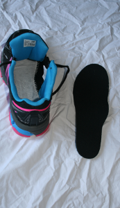 image showing removal of an existing insole as part of a series showing how to fit insoles