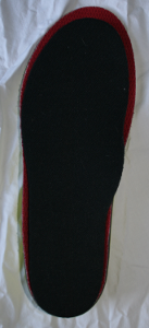 image showing insoles arranged for marking before trimming  as part of a series showing how to fit insoles